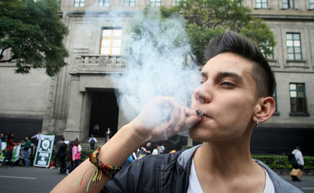 A young man smoking weed